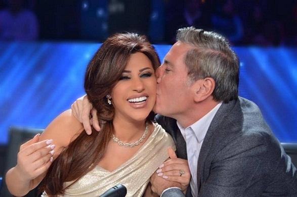 صور علي جابر يقبل نجوى كرم بحرارة فهل يتزوجها