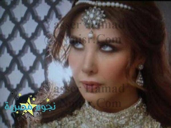 صور نانسي عجرم بملابس هويام حريم السلطان في كليبها الجديد 2014