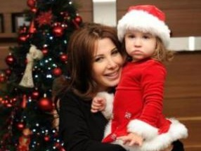 احتفال نانسى عجرم بالكريسماس 2014 , كيف احتفلت الفنانة نانسى عجرم بالكريسماس مع عائلتها 2014
