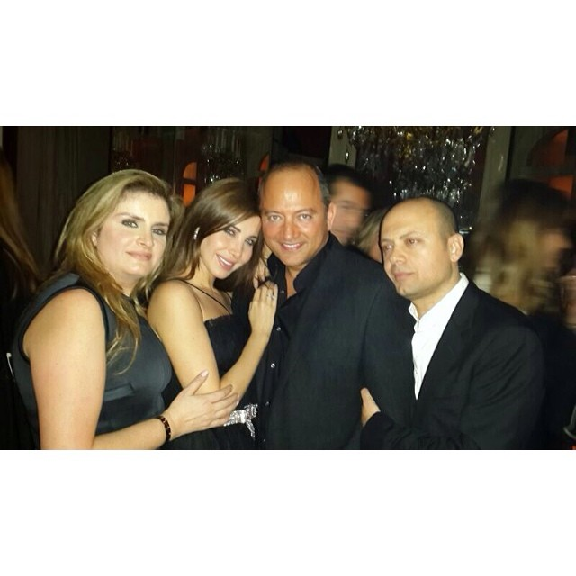 صور نانسي عجرم وزوجها يحتفلان مع ايلي صعب باطلاق مجموعته وعيد ميلاد زوجته في باريس 2014