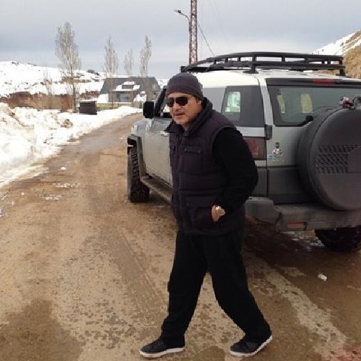 صور عاصي الحلاني يقضى يومه مع ابنه الوليد يتنزهان بسيارة على الثلج 2014