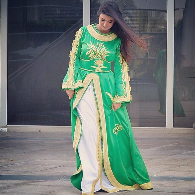 صور علا الفارس ترتدي قفطان سعودي باللون الأخضر فى اليوم الوطنى السعودى 1435