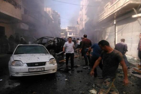 الاوضاع فى حلب , قتل 21 مدنيا من بينهم طفل وامراة فى قصف براميل متفجرة بطائرات حربية 9/11/2014