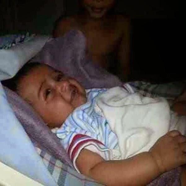 بالصور سعودي تفاجأ بوجود جني مبتسم وعريان الجسد بجوار طفله الجديد