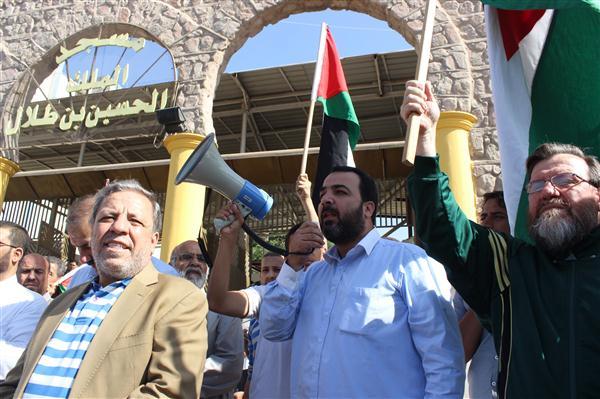 اعتقال ناجي علي مشارك بالوقفة في العقبة اليكم الصور