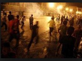 مشاجرة بين اشخاص في المشارع والامن يستخدم غاز مسيل للدموع