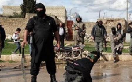 عقوبة داعش الارهابي لكل متعاون مع التحالف الصليبي شاهد الصور