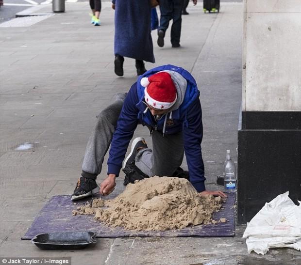 صور منحوتات مذهلة لكلاب من الرمال , حقيقة كلاب الرمال بالصور من فنانين الشوارع