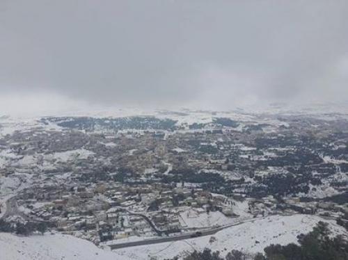 صور الثلج في محافظة الطفيلة القادسية